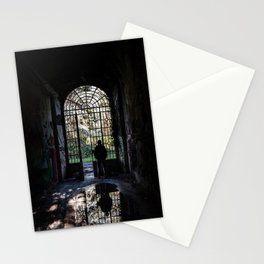 Silhouette of a man observing the outside world looking from the grate of a door Stationery Cards
