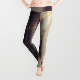 Closeup portrait of young woman with gold glitters on body Leggings