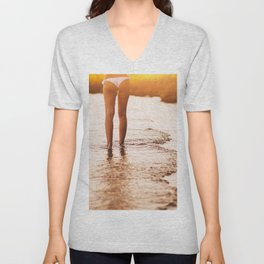 Low Section Of Young Woman in a white bikini walking Toward Sea on Beach at the sunset. Concept Summ Unisex V-Neck