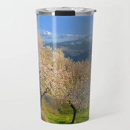 Flowering almond at the snowy mountains Travel Mug