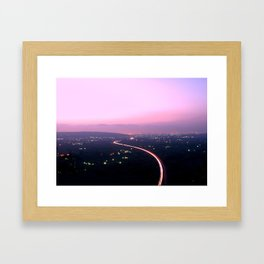 Highway Illuminated at Sunset by Driving Cars Framed Art Print
