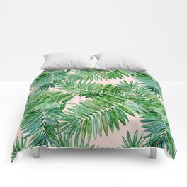 Green palm leaves on a light pink background. Comforters