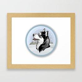 dog in snow Framed Art Print