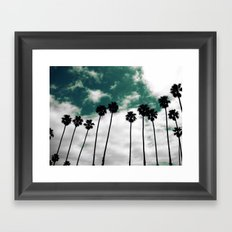 Palms in the sky Framed Art Print