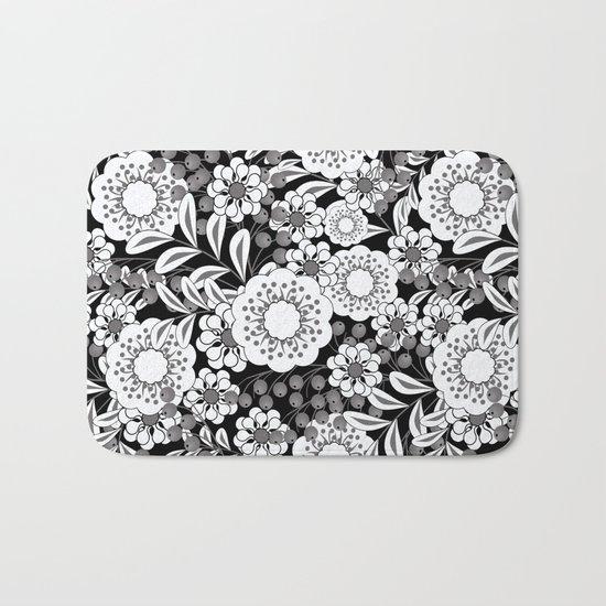 White flowers on a black background. Bath Mat
