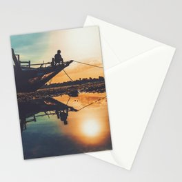 Kid sitting on a boat during the sunset Stationery Cards