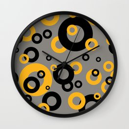 Rings in orange and black Wall Clock