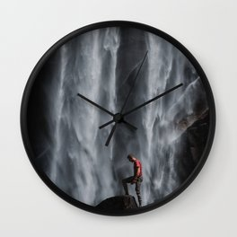 person-in-red-shirt-stepping-on-rock Wall Clock