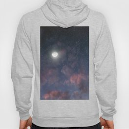 Glowing Moon on the night sky through pink clouds Hoody