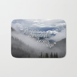 A journey of a thousand miles begins with a single step Bath Mat