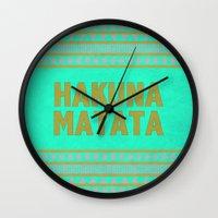 hakuna Wall Clocks featuring Hakuna Matata by M Studio