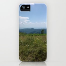 Meadow and mountains in the distance iPhone Case