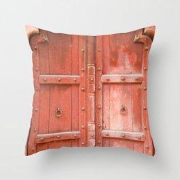 Ancient red wooden door in Agra, Uttar Pradesh, India Throw Pillow