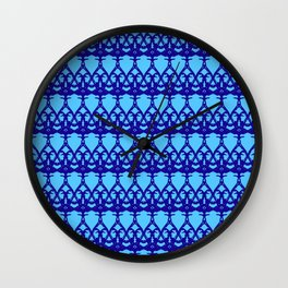 Wicker twisted pattern of wire and blue arrows on a light blue background. Wall Clock