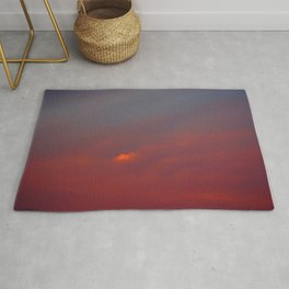 Red cloud shining at sunset Rug