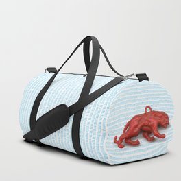 Red panther on blue grass Duffle Bag