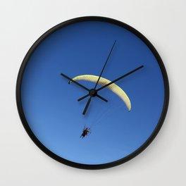 Pargliding man over bleu sky Wall Clock
