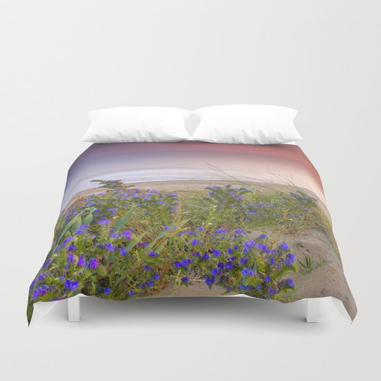 """Purple flowers at the sea sunset"" Duvet Cover"