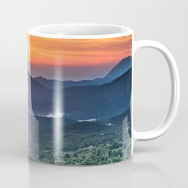 Beautiful sunset behind green fields Coffee Mug