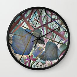 Leaves in abstraction with blue and red tint Wall Clock