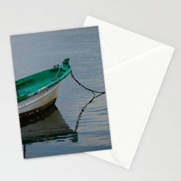 Boat docked in calm sea Stationery Cards