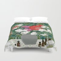 perfume Duvet Covers featuring Making perfume by Yuliya