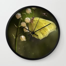 Yellow butterfly on lily of the valley flowers Wall Clock