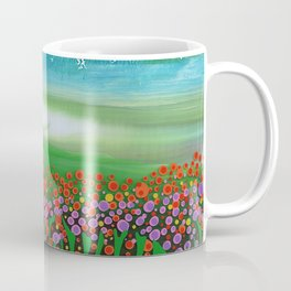 The meadow - A landscape in the background a blue sky and wildflowers Coffee Mug