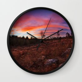 Beautiful vibrant sunset clouds view landscape in Finland Wall Clock