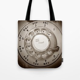 The dialer dials Tote Bag