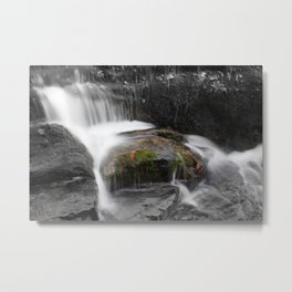 Relaxing water cascading over a moss covered rock Metal Print