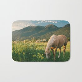 Pretty Horse Eating Grass in the Montana Sunset Bath Mat