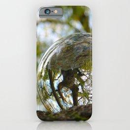 A tree seen through the glass ball iPhone Case
