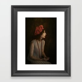 Girl with red necklace Framed Art Print