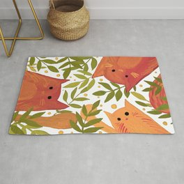 Cats and branches - orange and green Rug