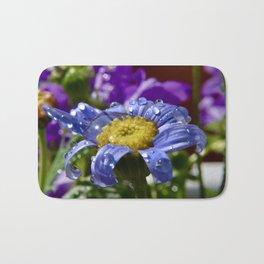 Macro shot summer flower with dew Bath Mat