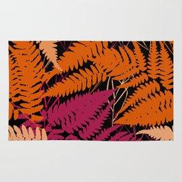 leafs tropical fern palm. orange pink brown silhouette on Black background Rug