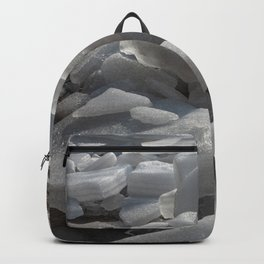Ice melts on the ground under the warm morning sun Backpack
