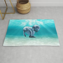 Two Manatees Swimming Rug