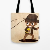 indiana jones Tote Bags featuring Indiana Jones by Delucienne Maekerr