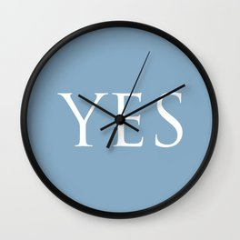 Word Yes on placid blue background Wall Clock