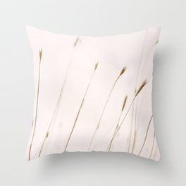 Tall grass against cloudy sky Throw Pillow
