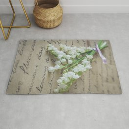 Love letter with lily of the valley Rug