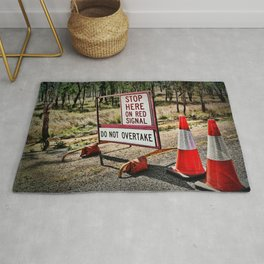 Stop on the red light - roadworks sign. Rug