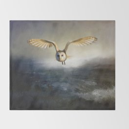 An owl flies over the lake Throw Blanket