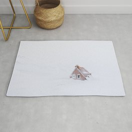 Minimalist orange house in a snowstorm in Iceland - Landscape Photography Rug