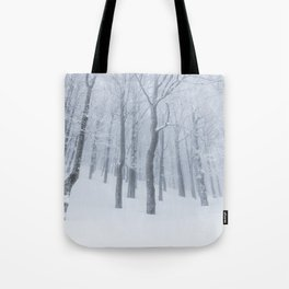 Snow covered frozen forest in winter Tote Bag