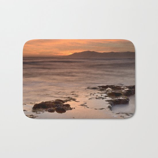 """Last red light"" Sunset at the sea Bath Mat"