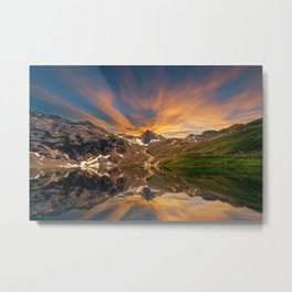 Lake surrounded by mountains cristal clear water with reflection of sky with yellow cloud in the Metal Print