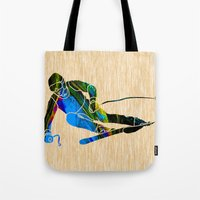 skiing Tote Bags featuring Skiing by marvinblaine